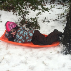 little girl sledding
